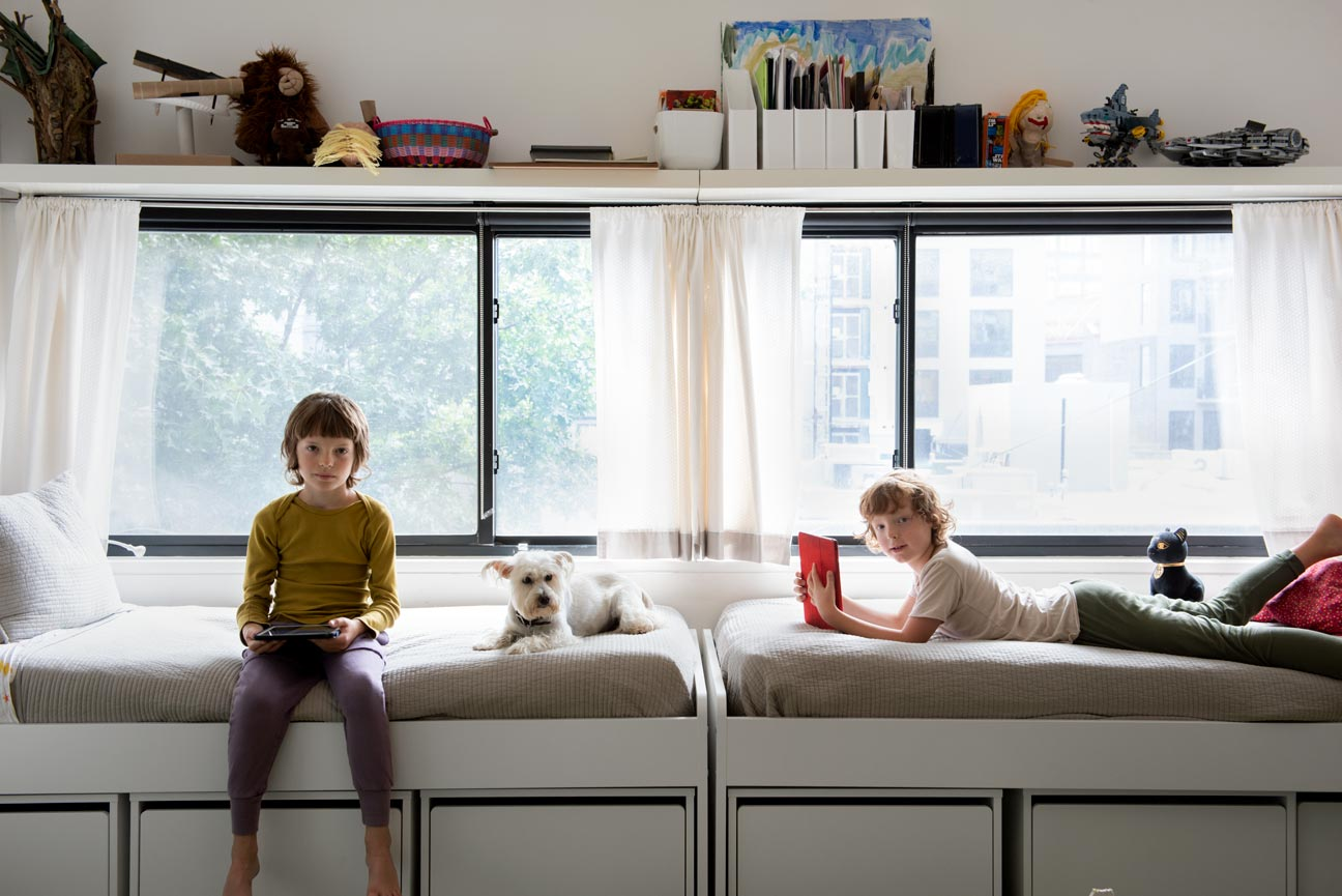 Portrait of young boys with dog and apple iPads