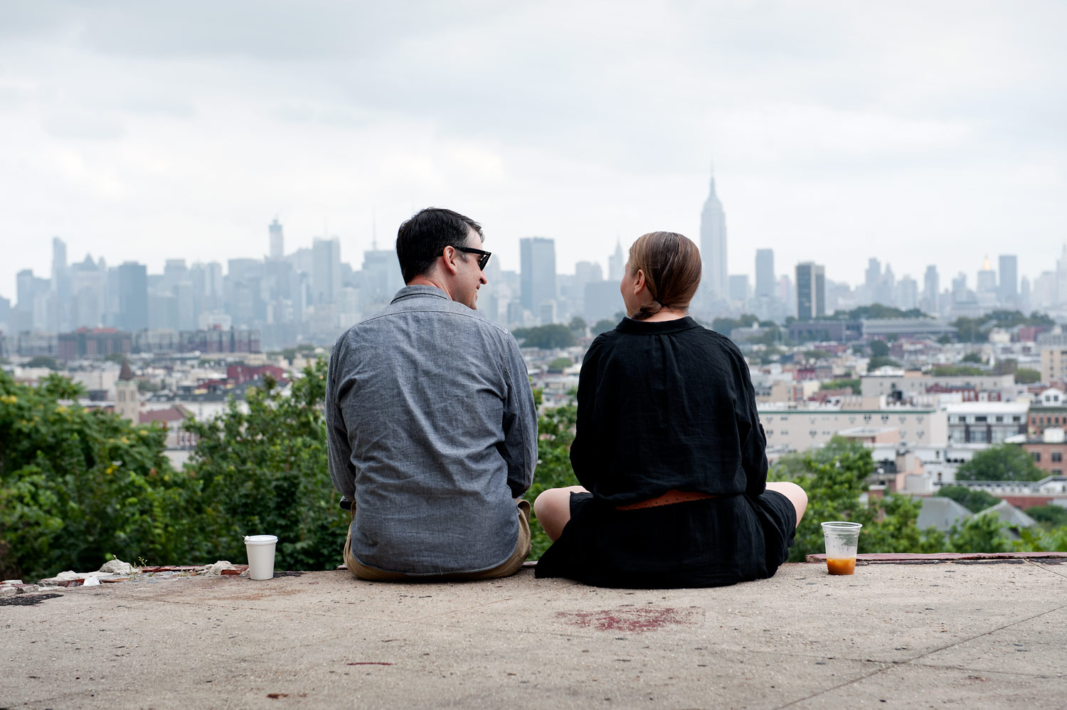 couple in front of a view of Manhattan skyline