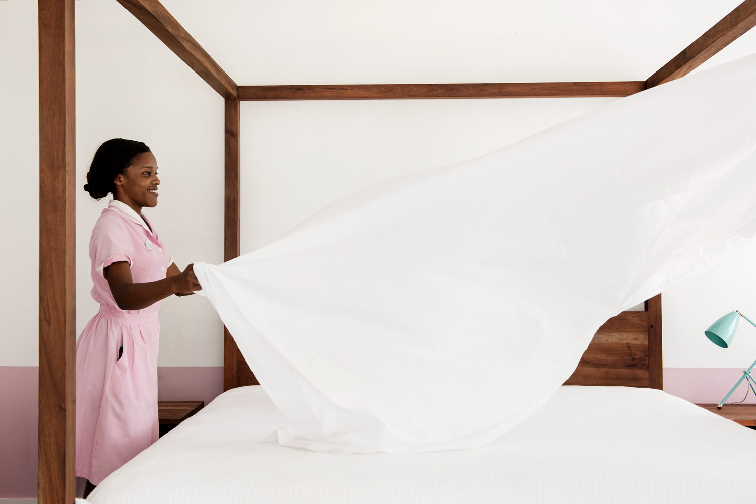 maid making bed at skylark hotel, Jamaica