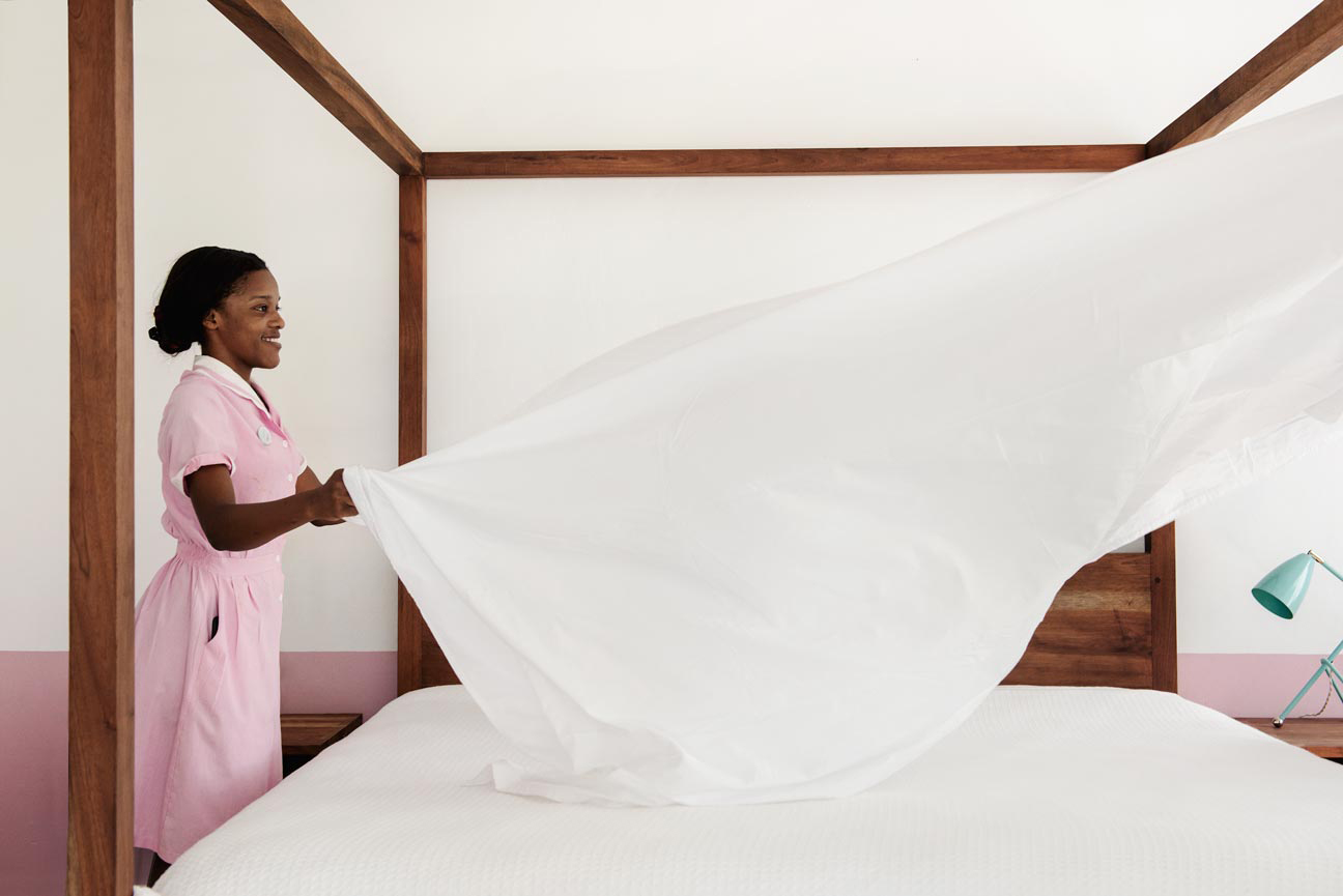 Maid makes a bed at Skylark resort, Jamaica